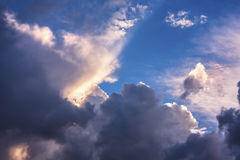 Colorful sky with clouds. A blue sky with clouds colored by the sun Royalty Free Stock Image