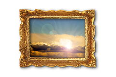 Colorful sky image in ancient gilded painting frame Stock Photography