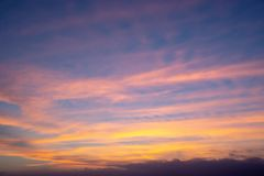 Colorful sky with clouds at sunset. Colorful sky with orange clouds at sunset royalty free stock photography