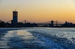 Colorful sky over Brooklyn Bridge, New York, USA Stock Photos