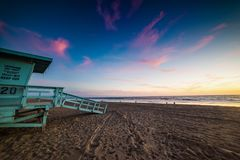Colorful sky over a lifeguard hut royalty free stock image