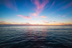 Colorful sky over Pacific Beach at sunset Royalty Free Stock Image