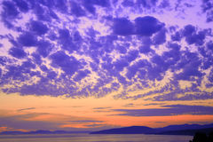 Colorful sky scene. At sunset above sea royalty free stock photo