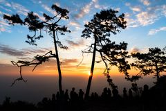 Colorful sky and silhouette of people seeing sunrise at Phukradueng National Park, Thailand. stock photography