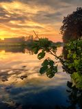 Colorful sky at sunrise over the river Stock Photos