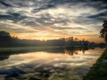 Colorful sky at sunrise over the river Stock Photo