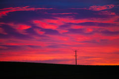 Colorful sky at sunrise with telephone pole and line Stock Photos