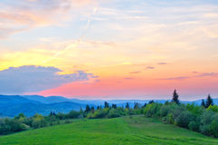 Colorful sky after sunset. In the mountains in the spring stock photography
