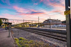 Colorful sky at a Swiss railway station Royalty Free Stock Photos