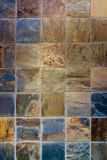Colorful slate. Colorful textured square slate tile wall Stock Photos
