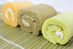 Colorful slice roll cake arrangement Stock Photography