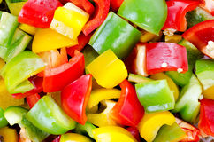Colorful sliced crop bell peppers Stock Images