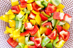 Colorful sliced and crop bell peppers closeup Stock Images