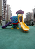 Colorful playground in Chinese apartment district Royalty Free Stock Photos