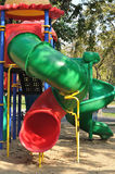 Colorful sliders in public playground in garden. Royalty Free Stock Photos