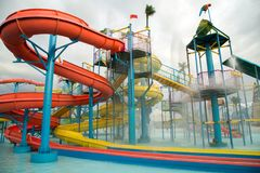 Sliders in the water park swimming pool Stock Images