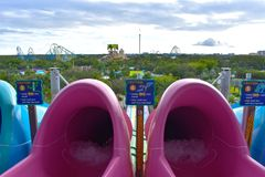 Colorful slides water ride attraction with top view of Seaworld and Aquatica Parks on cloudy s stock image