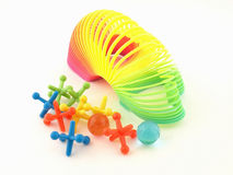 Colorful Slinky Toy and Jacks stock images