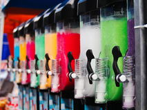Colorful slushie machines. In row during a festival stock photos
