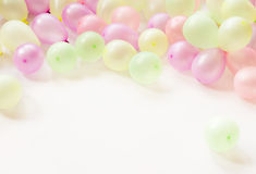 Colorful small baloons. On white background royalty free stock images