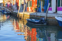 Colorful small, brightly painted houses on the island of Burano, Venice, Italy. Colorful small, brightly painted houses on the island of Burano, reflection in Stock Photos