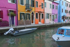 Colorful small, brightly painted houses on the island of Burano, Venice, Italy. Colorful small, brightly painted houses on the island of Burano, reflection in stock image