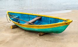 Beautiful photo of beached Fishing Canoe, the canoe is painted colorful in traditional asian manner. It is idle in off season royalty free stock image