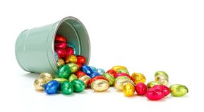 Chocolate eggs flowing from bucket Royalty Free Stock Photography