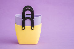 Colorful Small Decorative Plastic Bags with handle on Purple  Ba Royalty Free Stock Photography