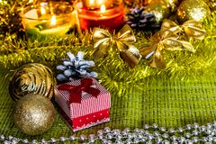 Colorful small gift boxes with gifts among Christmas tinsel and shiny toys and decorations royalty free stock photography