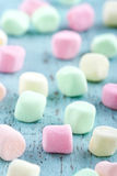 Colorful small marshmallows on wooden background Stock Images