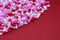 Red white pink heart shaped candy on red background royalty free stock photo