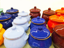 Colorful small pots for cooking. White, blue, brown, orange pots for cooking stock photos