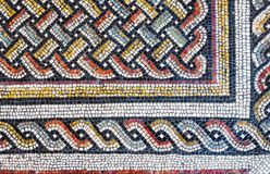Colorful small tiles of an ancient floor mosaic Stock Photos
