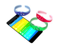 Colorful smart bands and smart phone isolated on white background Stock Photo