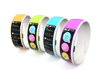 Colorful smart wristbands  on white background Royalty Free Stock Photos