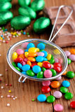 Colorful smarties in colander Stock Photography