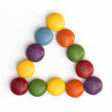 Colorful smarties in a triangle Royalty Free Stock Photography