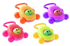 Colorful smiley baby rattle cars Stock Photos