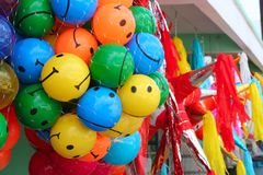 Colorful smiley balls and party pinata. In market in mexico royalty free stock images