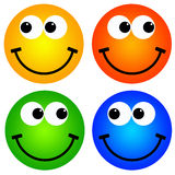 Colorful smileys. Colorful and happy smileys in yellow, orange, green and blue Royalty Free Stock Images