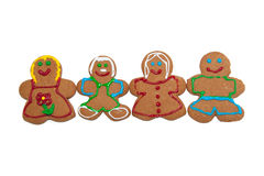 Colorful, smiling gingerbread men and women Stock Images