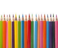 Colorful smiling pencils stock image