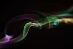 Colorful smoke. Colorful rainbow smoke, isolated on a black background Vector Illustration
