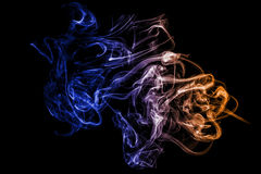 Colorful smoke on black. Royalty Free Stock Photography
