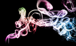 Colorful Smoke. On black background Stock Photos