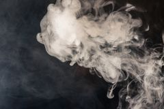 Colorful smoke on a black background of red and white colors. Th stock photos