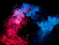 Colorful smoke on black background Royalty Free Stock Photos