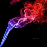 Colorful smoke on black background Stock Photography