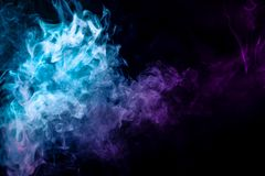 Colorful smoke  on a black isolated background stock photo